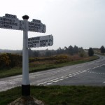 An old-style road sign showing the way to Forest Row and other towns.